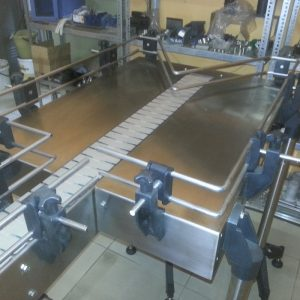 Tige Solutions Tab Chain Conveyor System